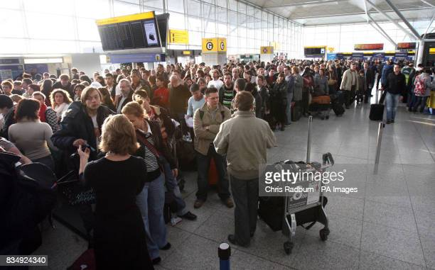 Delayed passengers queue at the Ryan Air checkin desks at Stansted Airport Essex following a protest by direct action group Plane Stupid
