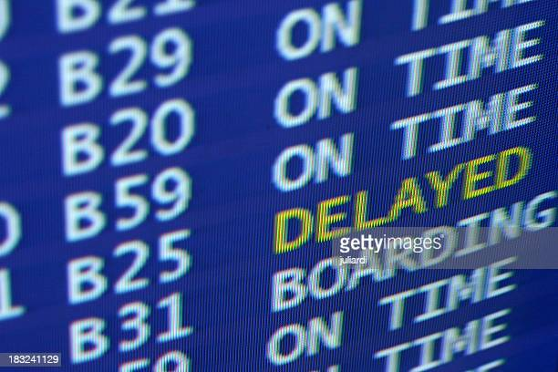 delayed sign at airport board schedule