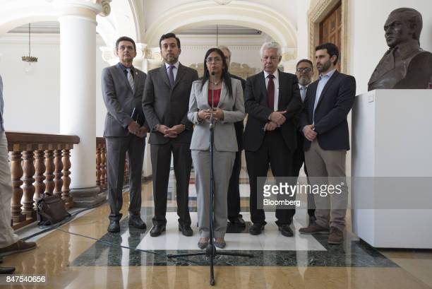 Delcy Rodriguez president of the Constituent Assembly center speaks next Arlindo Chinaglia a Brazilian lawmaker and head of Parlasur center right...