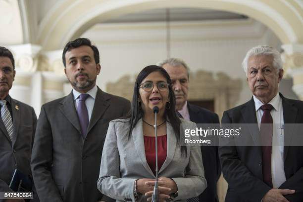 Delcy Rodriguez president of the Constituent Assembly center speaks next Arlindo Chinaglia a Brazilian lawmaker and head of Parlasur right during a...