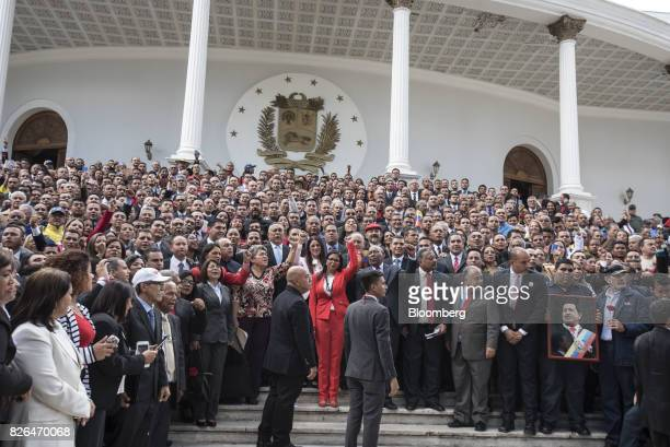 Delcy Rodriguez president of the Constituent Assembly center stands with members of the Assembly in Caracas Venezuela on Friday Aug 4 2017...