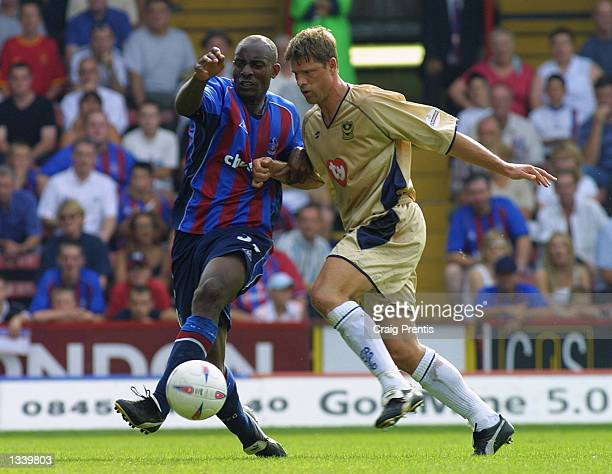 Dele Adebola of Crystal Palace [L] tussles with Arjan de Zeeuw of Portsmouth during the Crystal Palace v Portsmouth Nationwide League Division One...