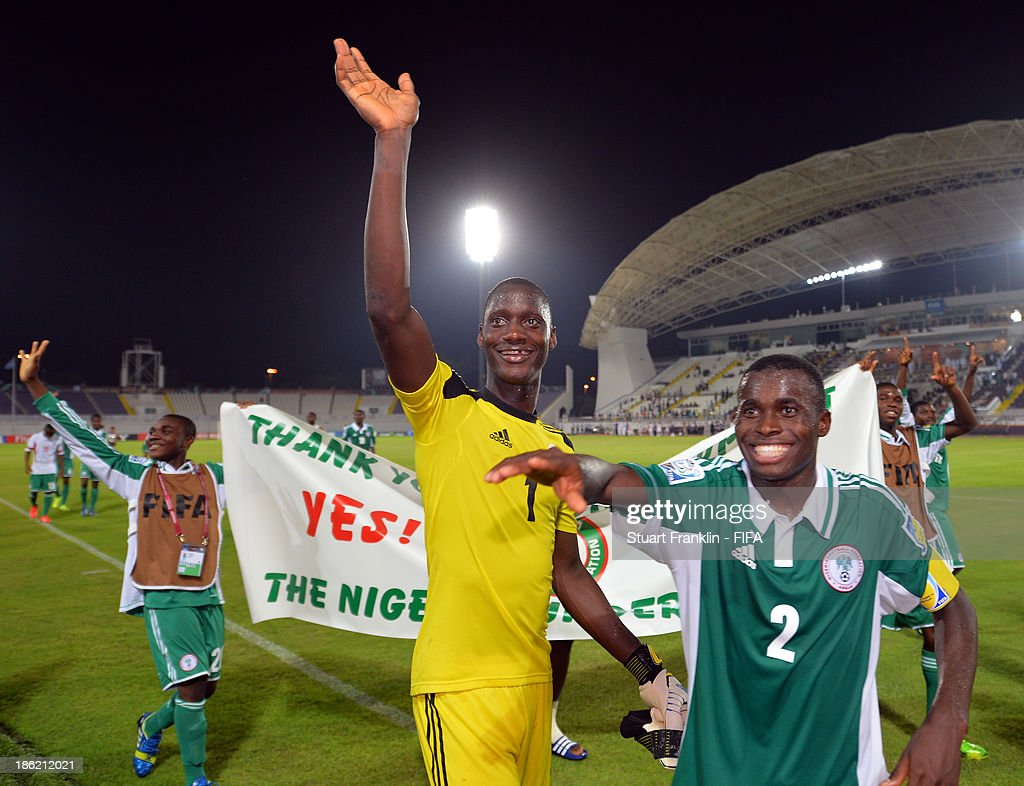 Dele Alampasu and Musa Muhammed of Nigeria celebrate their teams win at the end of the round of 16 match between Nigeria and Iran at Khalifa Bin Zayed Stadium on October 29, 2013 in Al Ain, United Arab Emirates.