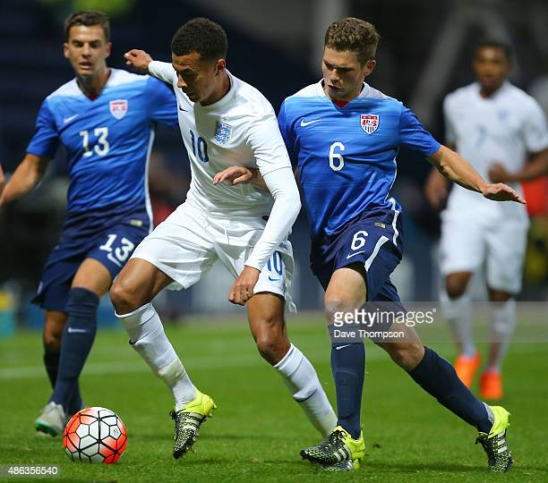 Dele Ali of England is challenged by Wil Trapp of USA during the International friendly match between England U21 and USA U23 at Deepdale on...