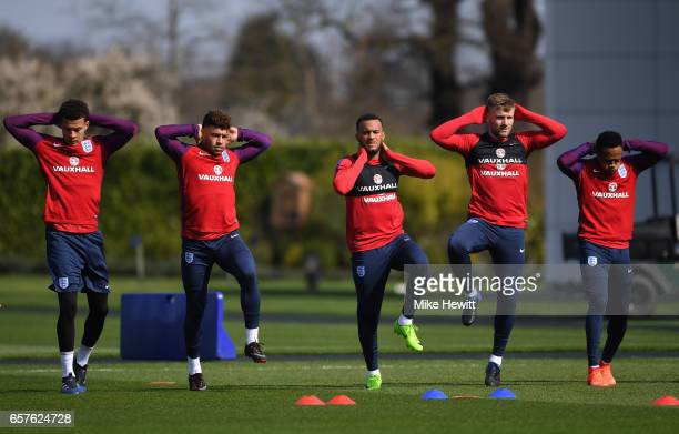 Dele Alli Alex OxladeChamberlain Ryan Bertrand Luke Shaw and Nathaniel Clyne of England run through drills during the England training session at the...
