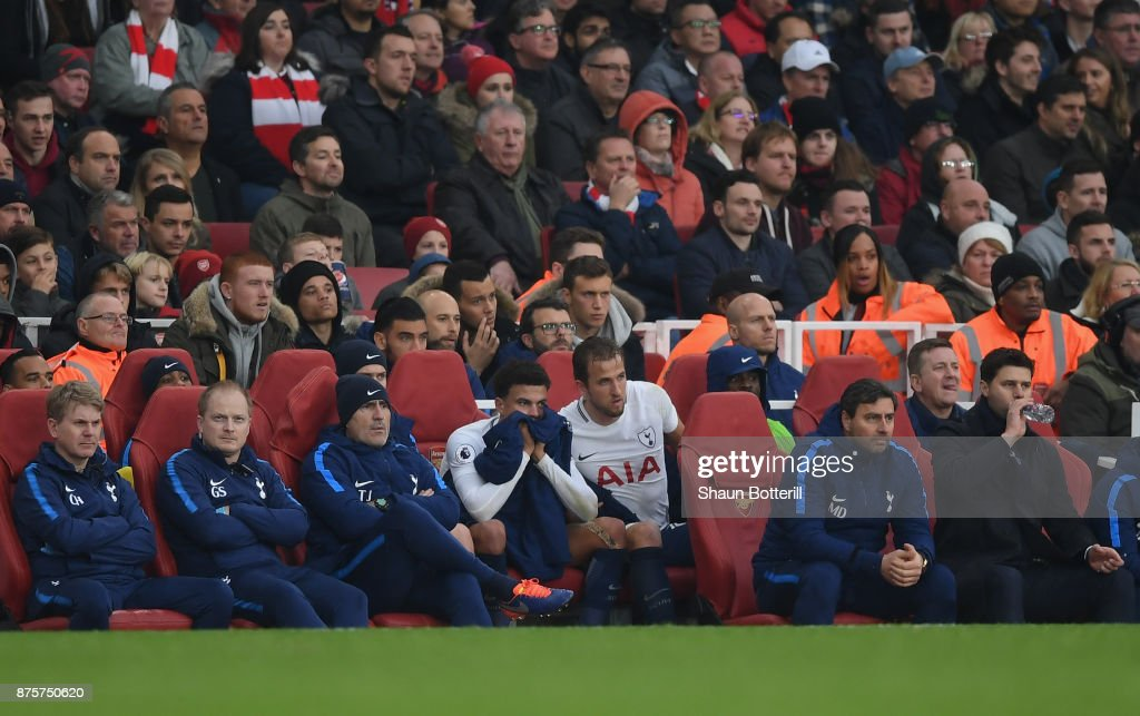 Dele Alli and Harry Kane of Tottenham Hotspur Tottenham Hotspur are substituted during the Premier League match between Arsenal and Tottenham Hotspur at Emirates Stadium on November 18, 2017 in London, England.