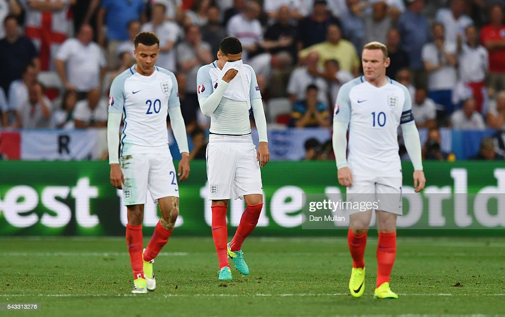 <a gi-track='captionPersonalityLinkClicked' href=/galleries/search?phrase=Dele+Alli&family=editorial&specificpeople=9976958 ng-click='$event.stopPropagation()'>Dele Alli</a>, <a gi-track='captionPersonalityLinkClicked' href=/galleries/search?phrase=Chris+Smalling&family=editorial&specificpeople=5964313 ng-click='$event.stopPropagation()'>Chris Smalling</a> and <a gi-track='captionPersonalityLinkClicked' href=/galleries/search?phrase=Wayne+Rooney&family=editorial&specificpeople=157598 ng-click='$event.stopPropagation()'>Wayne Rooney</a> of England show his dejection after Iceland's second goal during the UEFA EURO 2016 round of 16 match between England and Iceland at Allianz Riviera Stadium on June 27, 2016 in Nice, France.