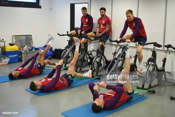Dele Alli Gary Cahill Michael Keane Eric Dier Kyle Walker and Joe Hart of England perform drills during an England training session on March 23 2017...