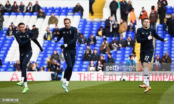 Dele Alli Harry Kane and Kevin Wimmer of Tottenham Hotspur warm up prior to the Barclays Premier League match between Tottenham Hotspur and AFC...