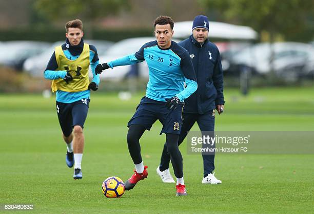 Dele Alli in action as Mauricio Pochettino manager of Tottenham Hotspur looks on during a Tottenham Hotspur training session at Tottenham Hotspur...