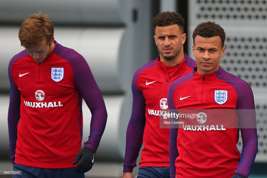Dele Alli; Kyle Walker and Eric Dier walk out during the England training session at Manchester City Football Academy on May 25, 2016 in Manchester, England.