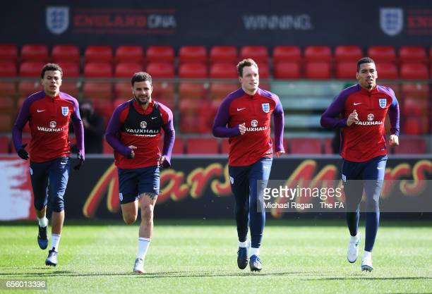 Dele Alli Kyle Walker Phil Jones and Chris Smalling of England warm up during an England training session at St Georges Park on March 21 2017 in...