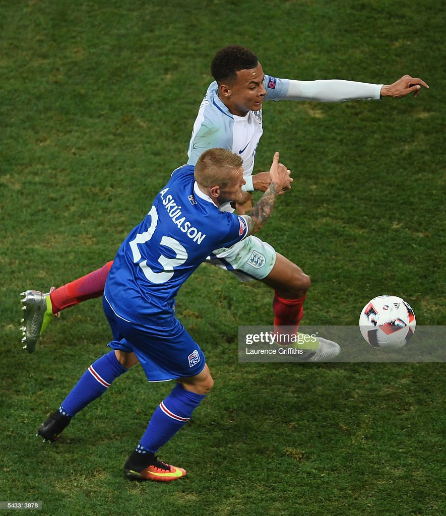 <a gi-track='captionPersonalityLinkClicked' href=/galleries/search?phrase=Dele+Alli&family=editorial&specificpeople=9976958 ng-click='$event.stopPropagation()'>Dele Alli</a> of England and Ari Skulason of Iceland compete for the ball during the UEFA EURO 2016 round of 16 match between England and Iceland at Allianz Riviera Stadium on June 27, 2016 in Nice, France.