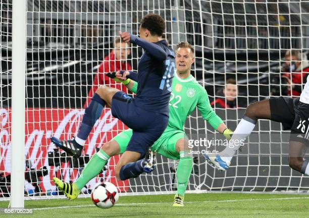 Dele Alli of England and goalkeeper of Germany MarcAndre ter Stegen in action during the international friendly match between Germany and England at...