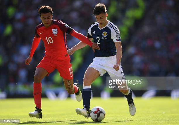 Dele Alli of England and Kieran Tierney of Scotland battle for possession during the FIFA 2018 World Cup Qualifier between Scotland and England at...