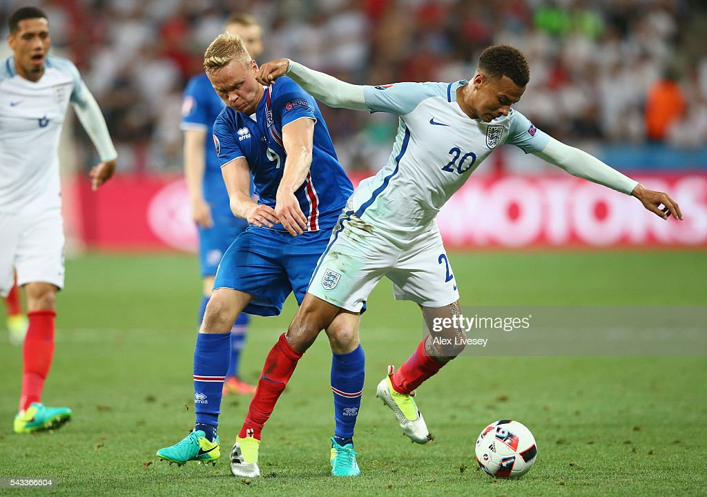 <a gi-track='captionPersonalityLinkClicked' href=/galleries/search?phrase=Dele+Alli&family=editorial&specificpeople=9976958 ng-click='$event.stopPropagation()'>Dele Alli</a> of England and <a gi-track='captionPersonalityLinkClicked' href=/galleries/search?phrase=Kolbeinn+Sigthorsson&family=editorial&specificpeople=4649188 ng-click='$event.stopPropagation()'>Kolbeinn Sigthorsson</a> of Iceland compete for the ball during the UEFA EURO 2016 round of 16 match between England and Iceland at Allianz Riviera Stadium on June 27, 2016 in Nice, France.