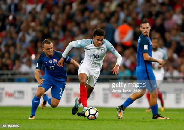 Dele Alli of England and Stanislav Lobotka of Slovakia during the FIFA 2018 World Cup Qualifier between England and Slovakia at Wembley Stadium on...