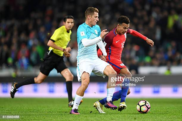 Dele Alli of England battles for the ball with Valter Birsa of Slovenia during the FIFA 2018 World Cup Qualifier Group F match between Slovenia and...