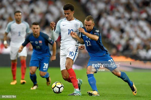 Dele Alli of England battles with Stanislav Lobotka of Slovakia during the FIFA 2018 World Cup Qualifier between England and Slovakia at Wembley...