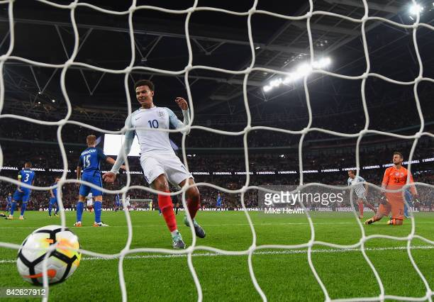 Dele Alli of England celebrates as Marcus Rashford of England scores their second goal as Martin Dubravka of Slovakia looks dejected during the FIFA...