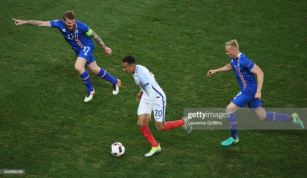 <a gi-track='captionPersonalityLinkClicked' href=/galleries/search?phrase=Dele+Alli&family=editorial&specificpeople=9976958 ng-click='$event.stopPropagation()'>Dele Alli</a> (C) of England competes for the ball against <a gi-track='captionPersonalityLinkClicked' href=/galleries/search?phrase=Aron+Gunnarsson&family=editorial&specificpeople=5490377 ng-click='$event.stopPropagation()'>Aron Gunnarsson</a> (L) and <a gi-track='captionPersonalityLinkClicked' href=/galleries/search?phrase=Kolbeinn+Sigthorsson&family=editorial&specificpeople=4649188 ng-click='$event.stopPropagation()'>Kolbeinn Sigthorsson</a> (R) of Iceland during the UEFA EURO 2016 round of 16 match between England and Iceland at Allianz Riviera Stadium on June 27, 2016 in Nice, France.