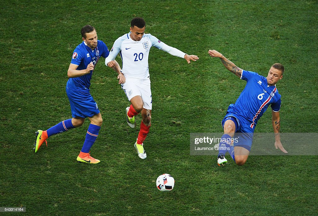 <a gi-track='captionPersonalityLinkClicked' href=/galleries/search?phrase=Dele+Alli&family=editorial&specificpeople=9976958 ng-click='$event.stopPropagation()'>Dele Alli</a> (C) of England competes for the ball against <a gi-track='captionPersonalityLinkClicked' href=/galleries/search?phrase=Gylfi+Sigurdsson&family=editorial&specificpeople=6401581 ng-click='$event.stopPropagation()'>Gylfi Sigurdsson</a> (L) and Ragnar Sigurdsson (R) of Iceland during the UEFA EURO 2016 round of 16 match between England and Iceland at Allianz Riviera Stadium on June 27, 2016 in Nice, France.
