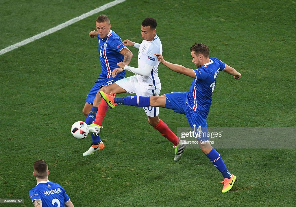 <a gi-track='captionPersonalityLinkClicked' href=/galleries/search?phrase=Dele+Alli&family=editorial&specificpeople=9976958 ng-click='$event.stopPropagation()'>Dele Alli</a> (C) of England competes for the ball against Ragnar Sigurdsson (L) and Kari Arnason (R) of Iceland during the UEFA EURO 2016 round of 16 match between England and Iceland at Allianz Riviera Stadium on June 27, 2016 in Nice, France.