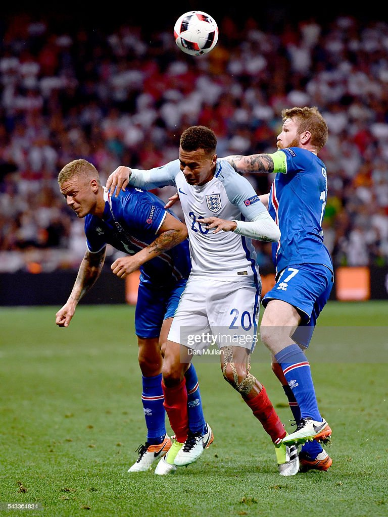 <a gi-track='captionPersonalityLinkClicked' href=/galleries/search?phrase=Dele+Alli&family=editorial&specificpeople=9976958 ng-click='$event.stopPropagation()'>Dele Alli</a> (C) of England competes for the ball against Ragnar Sigurdsson (L) and <a gi-track='captionPersonalityLinkClicked' href=/galleries/search?phrase=Aron+Gunnarsson&family=editorial&specificpeople=5490377 ng-click='$event.stopPropagation()'>Aron Gunnarsson</a> (R) of Iceland during the UEFA EURO 2016 round of 16 match between England and Iceland at Allianz Riviera Stadium on June 27, 2016 in Nice, France.