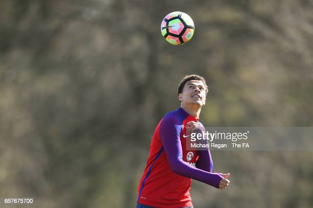 Dele Alli of England controls the ball during the England training session at the Tottenham Hotspur Training Centre on March 25 2017 in Enfield...