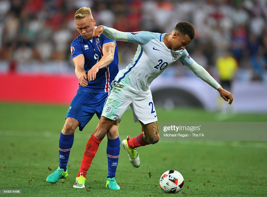 <a gi-track='captionPersonalityLinkClicked' href=/galleries/search?phrase=Dele+Alli&family=editorial&specificpeople=9976958 ng-click='$event.stopPropagation()'>Dele Alli</a> of England controls the ball under pressure of <a gi-track='captionPersonalityLinkClicked' href=/galleries/search?phrase=Kolbeinn+Sigthorsson&family=editorial&specificpeople=4649188 ng-click='$event.stopPropagation()'>Kolbeinn Sigthorsson</a> of Iceland during the UEFA EURO 2016 round of 16 match between England and Iceland at Allianz Riviera Stadium on June 27, 2016 in Nice, France.
