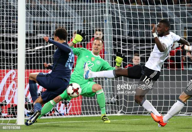 Dele Alli of England goalkeeper of Germany MarcAndre ter Stegen and Antonio Toni Rudiger of Germany in action during the international friendly match...