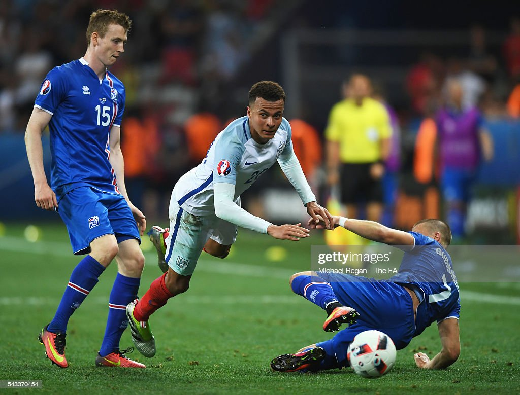 <a gi-track='captionPersonalityLinkClicked' href=/galleries/search?phrase=Dele+Alli&family=editorial&specificpeople=9976958 ng-click='$event.stopPropagation()'>Dele Alli</a> of England is challenged by Johann Gudmundsson of Iceland during the UEFA EURO 2016 round of 16 match between England and Iceland at Allianz Riviera Stadium on June 27, 2016 in Nice, France.