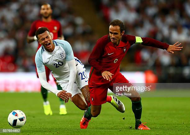 Dele Alli of England is challenged by Ricardo Carvalho of Portugal during the international friendly match between England and Portugal at Wembley...