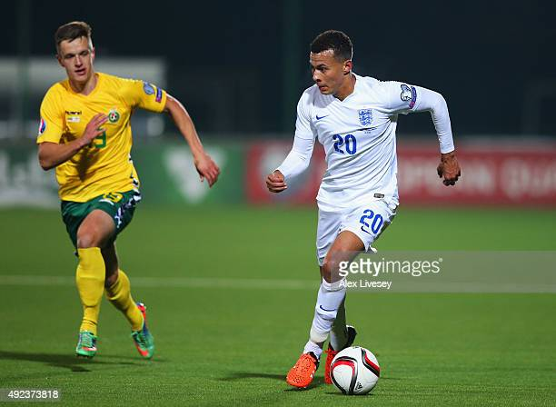 Dele Alli of England is chased by Deimantas Petravicius of Lithuania during the UEFA EURO 2016 qualifying Group E match between Lithuania and England...