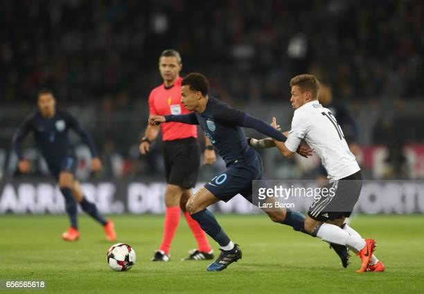 Dele Alli of England is put under pressure from Joshua Kimmich of Germany during the international friendly match between Germany and England at...