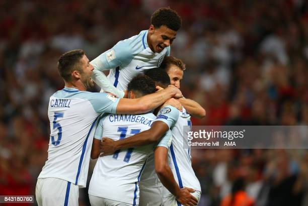 Dele Alli of England jumps up as the team celebrate after Marcus Rashford of England scores to make it 21 during the FIFA 2018 World Cup Qualifier...