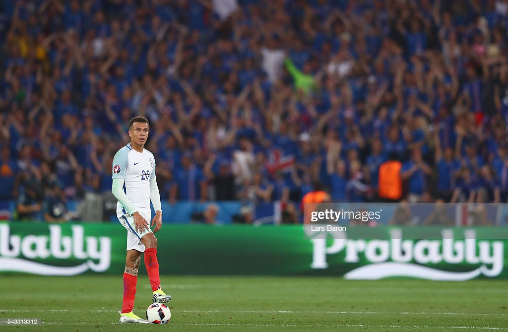<a gi-track='captionPersonalityLinkClicked' href=/galleries/search?phrase=Dele+Alli&family=editorial&specificpeople=9976958 ng-click='$event.stopPropagation()'>Dele Alli</a> of England reacts after Iceland's second goal during the UEFA EURO 2016 round of 16 match between England and Iceland at Allianz Riviera Stadium on June 27, 2016 in Nice, France.