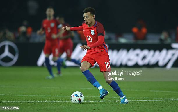 Dele Alli of England runs with the ball during the International Friendly match between Germany and England at Olympiastadion on March 26 2016 in...