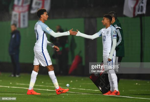 Dele Alli of England shakes hands with Jesse Lingard of England as he is substituted during the FIFA 2018 World Cup Group F Qualifier between...