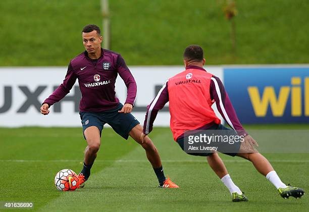Dele Alli of England turns from Kyle Walker during the England training session at St Georges Park on October 7 2015 in BurtonuponTrent England