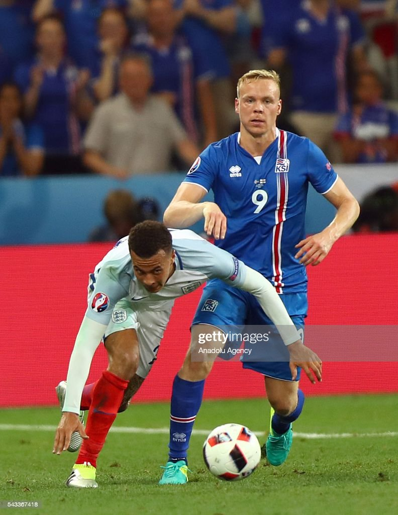 Dele Alli of England (L) vies with Kolbeinn Sigthorsson of Iceland (R) during the UEFA Euro 2016 Round of 16 football match between Iceland and England at Stade de Nice in Nice, France on June 27, 2016.