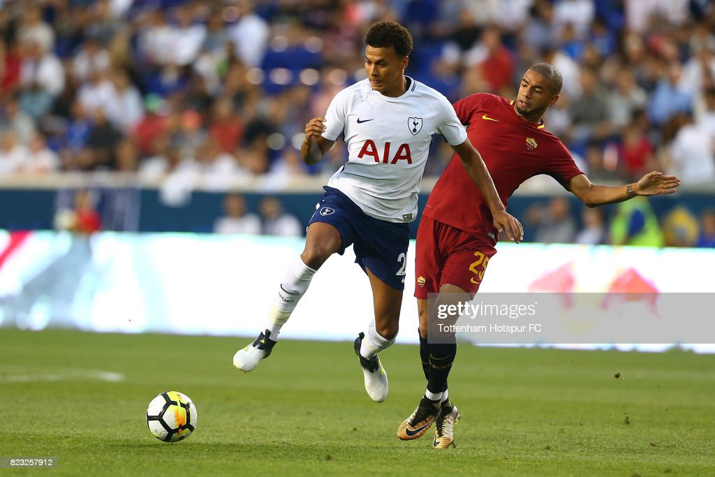 Dele Alli #20 of Tottenham Hotspur and Bruno Peres #25 of Roma vie for the ball during the International Champions Cup 2017 at Red Bull Arena on July 25, 2017 in Harrison, New Jersey.