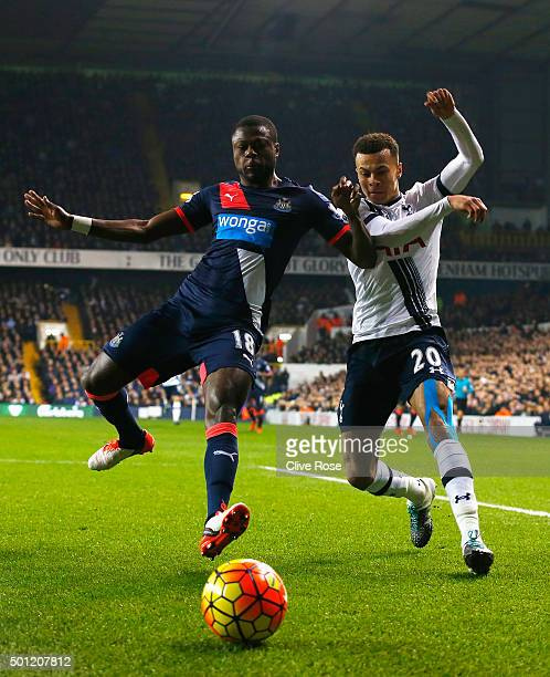 Dele Alli of Tottenham Hotspur and Chancel Mbemba of Newcastle United battle for the ball during the Barclays Premier League match between Tottenham...