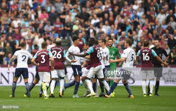 Dele Alli of Tottenham Hotspur and Cheikhou Kouyate of West Ham United clash during the Premier League match between West Ham United and Tottenham...