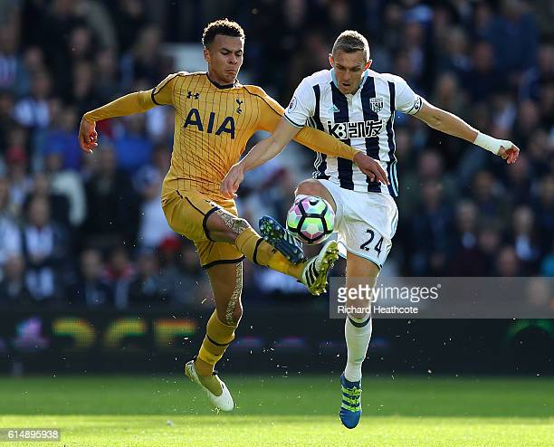 Dele Alli of Tottenham Hotspur and Darren Fletcher of West Bromwich Albion battle for possession during the Premier League match between West...