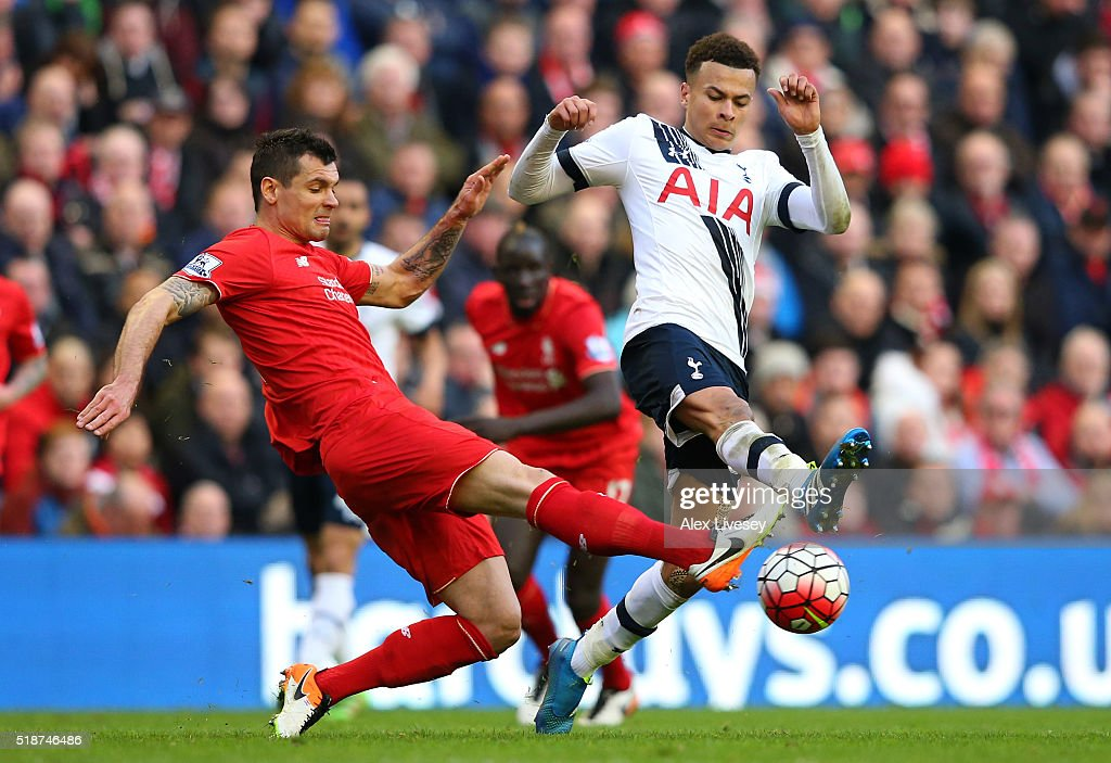 Dele Alli of Tottenham Hotspur and Dejan Lovren of Liverpool compete for the ball during the Barclays Premier League match between Liverpool and...
