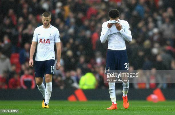 Dele Alli of Tottenham Hotspur and Eric Dier of Tottenham Hotspur are dejeted after the Premier League match between Manchester United and Tottenham...