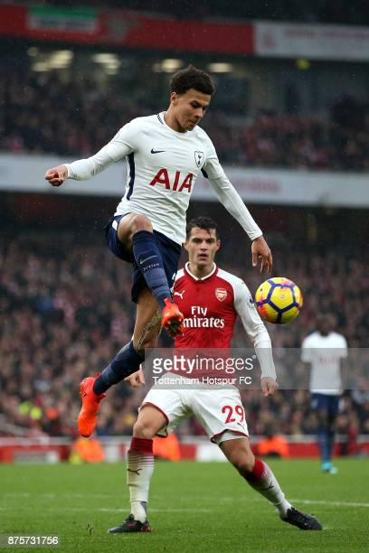 Dele Alli of Tottenham Hotspur and Granit Xhaka of Arsenal in action during the Premier League match between Arsenal and Tottenham Hotspur at...