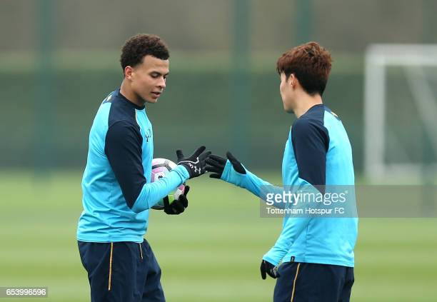 Dele Alli of Tottenham Hotspur and HeungMin Son of Tottenham Hotspur practice their handshake during a Tottenham Hotspur training session at the...