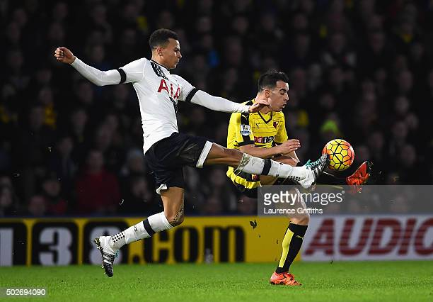 Dele Alli of Tottenham Hotspur and Jose Manuel Jurado of Watford compete for the ball during the Barclays Premier League match between Watford and...